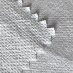 WF1 / O9TO5 SS + PTFE Netkaná textília laminovaná mliečnou priedušnou membránou PTFE z lekárskeho ochranného odevu
